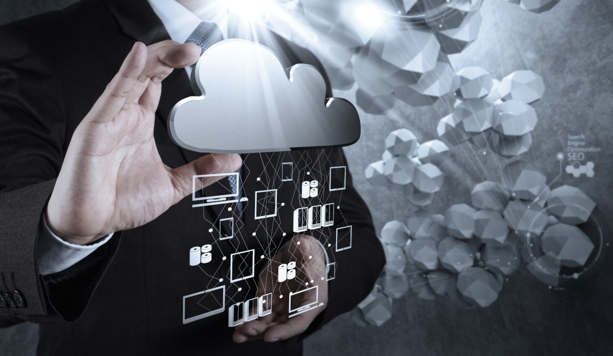 Business man with hands in front of cloud with technology icons