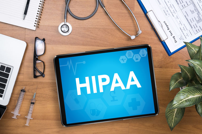 HIPAA displayed on tablet along with doctors equipment