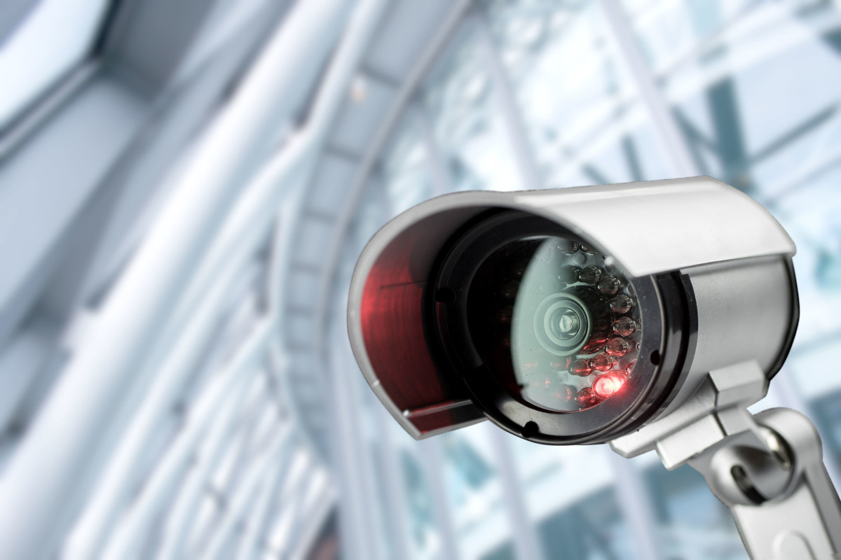 A cylindrical modern security camera.