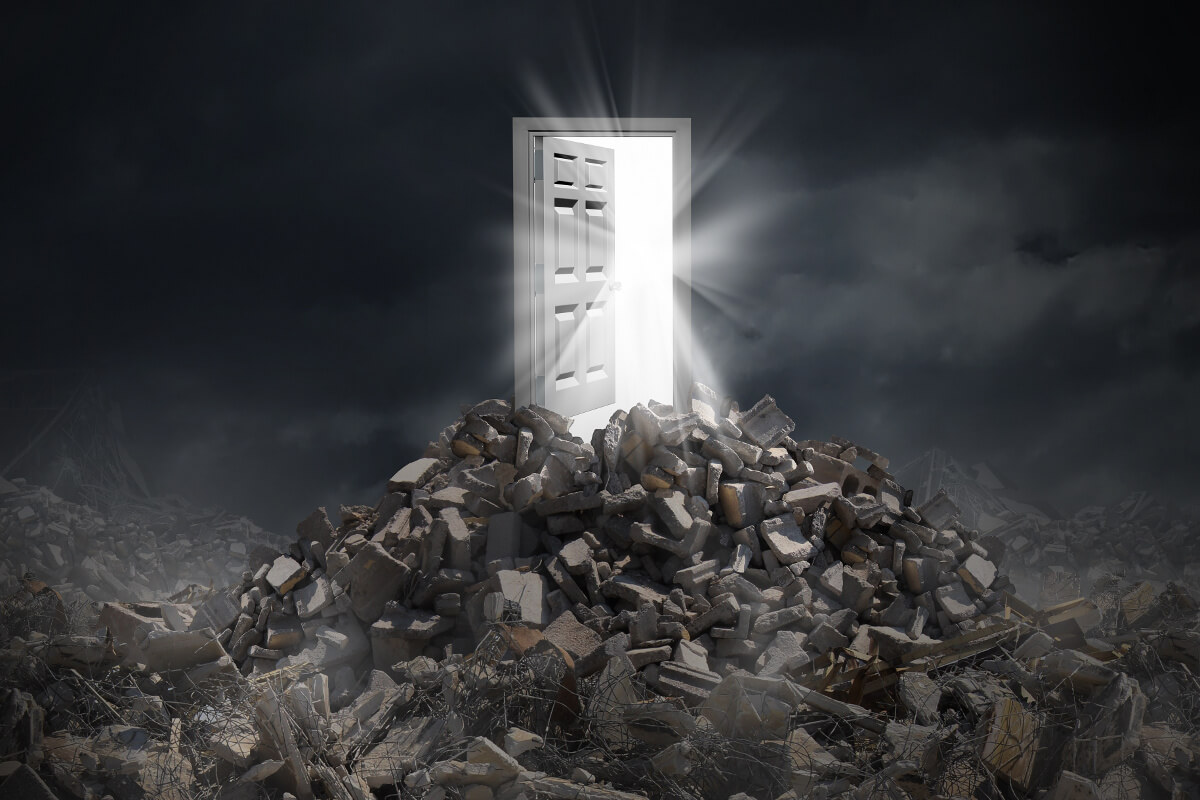 Open Door with Light Spilling Out Standing in Rubble